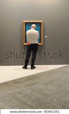 MILAN - APRIL 08: An unidentified man looks at paintings and sculpture galleries during MiArt, international exhibition of modern and contemporary art on April 08, 2011 in Milan, Italy