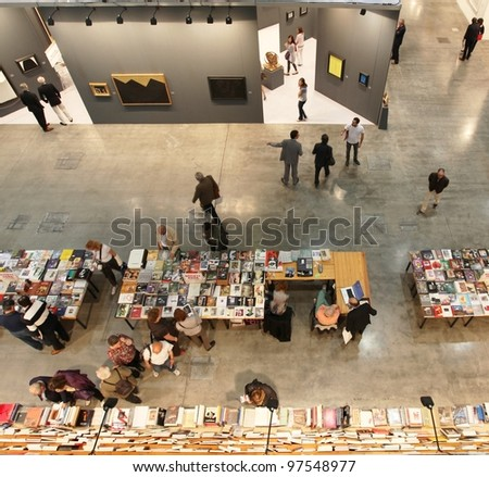 MILAN - APRIL 08: Panoramic view of people visiting arts book shop during MiArt, international exhibition of modern and contemporary art on April 08, 2011 in Milan, Italy.