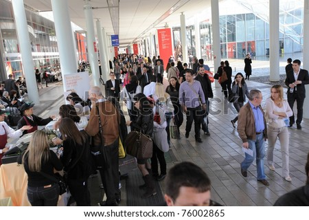 MILAN - APRIL 13: People at the entrance of Salone del Mobile, international furnishing accessories exhibition on April 13, 2011 in Milan, Italy. - stock photo
