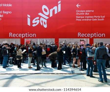 MILAN - APRIL 17: People  enter interior design pavilions at Salone del Mobile, international furnishing accessories exhibition on April 17, 2012 in Milan, Italy.