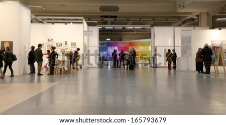 MILAN - APRIL 07: People look at art galleries during MiArt, international exhibition of modern and contemporary art April 07, 2013 in Milan, Italy.