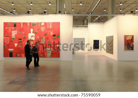 MILAN - APRIL 08: People look at painting and sculpture art galleries during MiArt ArtNow, international exhibition of modern and contemporary art on April 08, 2011 in Milan, Italy.