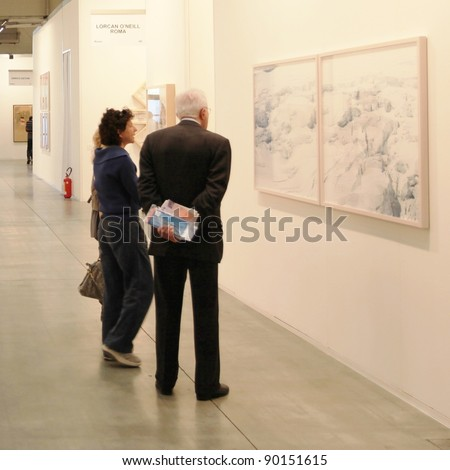 MILAN - APRIL 08: People look at paintings galleries during MiArt, international exhibition of modern and contemporary art on April 08, 2011 in Milan, Italy.