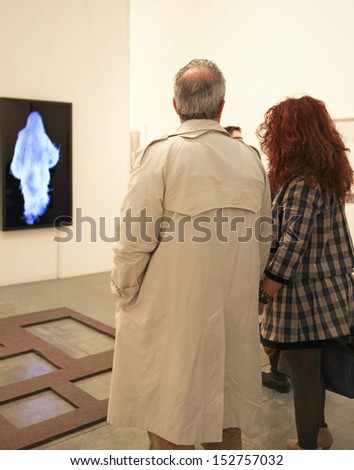 MILAN - APRIL 07: People look at paintings gallery at MiArt, international exhibition of modern and contemporary art April 07, 2013 in Milan, Italy.