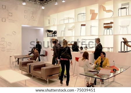 MILAN - APRIL 15: People visit interior design stands in exhibition at Salone del Mobile, international furnishing accessories exhibition April 15, 2010 in Milan, Italy. #75039451