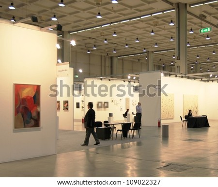 MILAN - APRIL 08: People visit paintings and sculpture work of arts galleries during MiArt, international exhibition of modern and contemporary art on April 08, 2011 in Milan, Italy.
