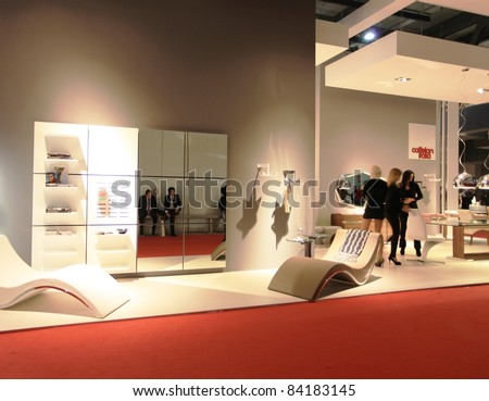 MILAN - APRIL 13: Visitors look at interiors design and home architecture solutions, Salone del Mobile, international furnishing accessories exhibition on April 13, 2011 in Milan, Italy.