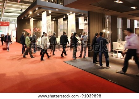 MILAN - APRIL 13: Visitors look at interiors design stands and home architecture solutions during Salone del Mobile, international furnishing accessories exhibition on April 13, 2011 in Milan, Italy.
