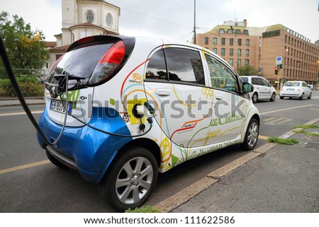 MILAN - AUGUST 31: Electric vehicle in car sharing station. This innovative service allows to pick up and deposit cars in various parking areas around the city, on August 31, 2012 in Milan, Italy