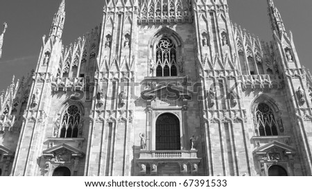 Milan Cathedral (Duomo di Milano), in Italy - (16:9 black and white) - stock photo