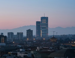 Milan cityscape at sunset with new skyscrapers of CityLife district and the Monte Rosa mountain on the background