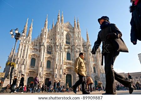 MILAN - DECEMBER 11: Tourists at Piazza Duomo on December 11, 2009 in Milan, Italy. As of 2006, Milan was the 42nd most visited city worldwide, with 1.9 million annual international visitors. - stock photo