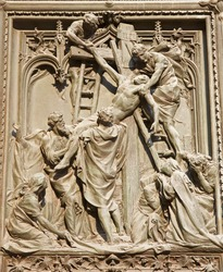 Milan - detail from main bronze gate - deposition from the cross