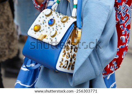 MILAN - FEBRUARY 25: Woman poses for photographers with backpack with gems before Gucci show Milan Fashion Week Day 1, Fall/Winter 2015/2016 street style day 1, on February 25, 2015 in Milan.