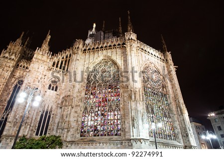 Milan gothic cathedral windows at night, Italy