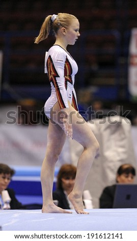 MILAN, ITALY-APRIL 02, 2009: a female gymnast playing floor exercise, during the European Artistic Gymnastic Championship, in Milan.