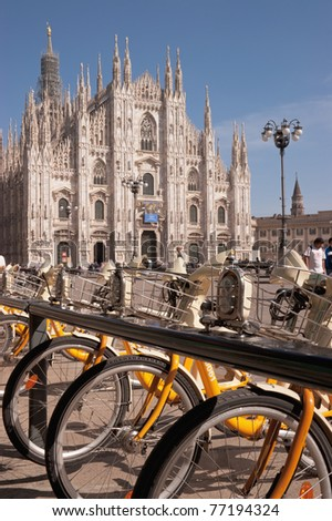MILAN, ITALY - APRIL 7: BikeMi bicycles at a docking station in Piazza del Duomo on April 7, 2011 in Milan. BikeMi is a bike sharing service designed to promote users mobility and to reduce traffic.