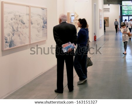MILAN, ITALY - APRIL 08: Couple looking at paintings galleries during MiArt, international exhibition of modern and contemporary art on April 08, 2011 in Milan, Italy