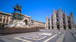 Milan, Italy, April, 2020: empty square in front of the cathedral. Empty streets. Desert city. Piazza Duomo a Milano. Historical architecture. Blue sky