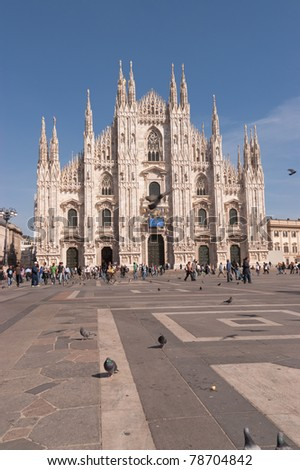 MILAN, ITALY - APRIL 7: Gothic facade of Milan cathedral in Piazza del Duomo on April 7, 2011 in Milan. Built during six centuries (from 14th to 20th century) it is the 4th largest church in the world