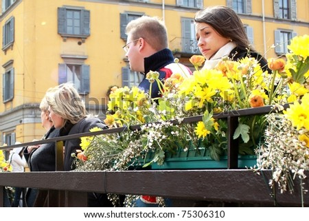 MILAN, ITALY - APRIL 11: People look for flowers and garden products at the annual Flowers Market in the fashion and culture Navigli area April 11, 2010 in Milan, Italy.