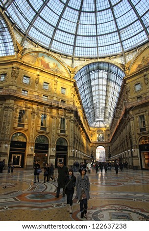 MILAN, ITALY - DECEMBER 31: People walking inside the Galleria Vittorio Emanuele - famous shopping gallery with elegant boutiques and fashion creator outlets on December 31, 2010 in Milan, Italy