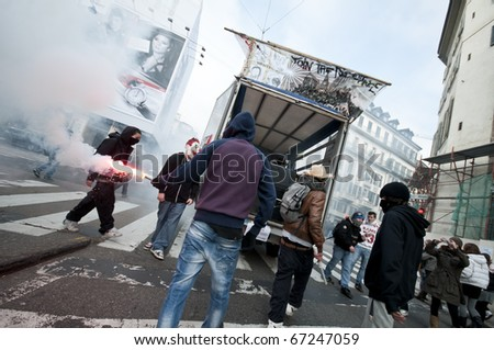 MILAN, ITALY - DECEMBER 14: student demonstration held in Milan December 14, 2010. Students protest against Berlusconi's government and against the new laws on school education minister Gelmini. - stock photo
