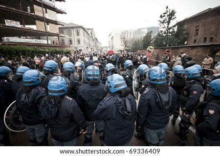 MILAN, ITALY - DECEMBER 22: student demonstration held in Milan December 22, 2010. Students protest against Berlusconi's government and against the new laws on school education minister Gelmini. - stock photo