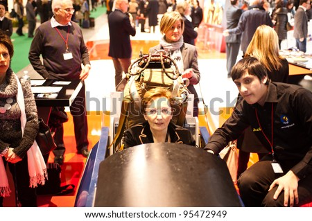 MILAN, ITALY - FEBRUARY 17: A visitor tries a a flight simulator at BIT International Tourism Exchange on february 17, 2012 in Milan, Italy.