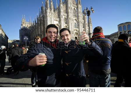 MILAN, ITALY - FEBRUARY 15: Arsenal fans celebrate before the match in Piazza Duomo on February, 15 2010. during the celebrations they have been drinking liters of beer and had problems with police