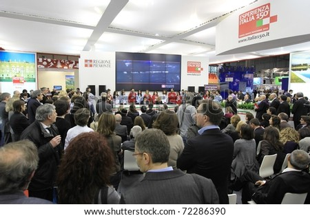MILAN, ITALY - FEBRUARY 17: Crowd at conference meeting, Piemonte regional stand, BIT, International Tourism Exchange Exhibition on February 17, 2011 in Milan, Italy.