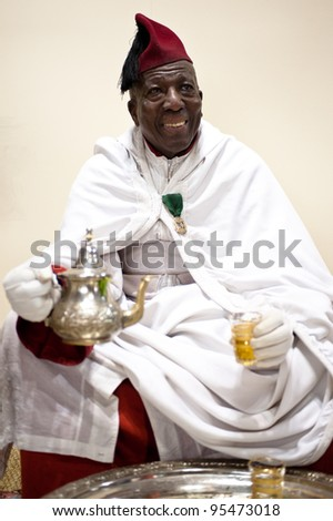 MILAN, ITALY - FEBRUARY 17: Old man serving tea at BIT International Tourism Exchange on february 17, 2012 in Milan, Italy.