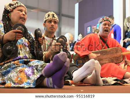 MILAN, ITALY - FEBRUARY 17: People singing at Africa stands area during BIT, International Tourism Exchange Exhibition on February 17, 2011 in Milan, Italy.
