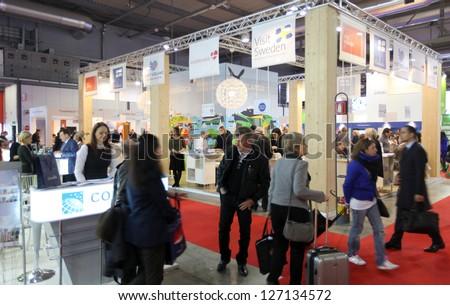 MILAN, ITALY - FEBRUARY 16: People visit international exhibition area during BIT, International Tourism Exchange Exhibition on February 16, 2012 in Milan, Italy.