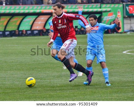 MILAN, ITALY - FEBRUARY 05: Zlatan Ibrahimovic(11) and Walter Gargano (23)  in action during match Sere A AC Milan - Napoli (0:0) at the stadium San Siro on February 05, 2012 in Milan, Italy.