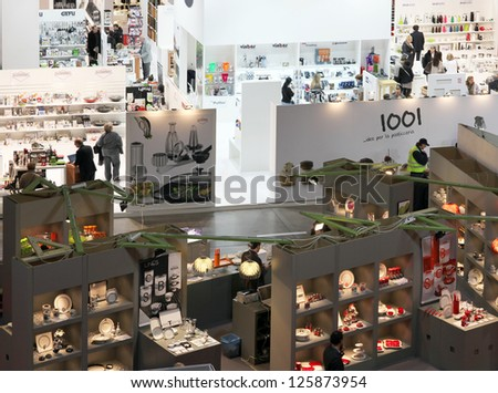MILAN, ITALY - JAN 24: Panoramic view of people visiting home accessories and furnishing stands at Macef, International Home Show Exhibition January 24, 2013 in Milan, Italy.