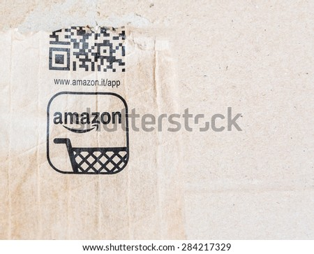 MILAN, ITALY - JANUARY 3, 2015: detail of delivered Amazon parcel in Milan, Italy. Amazon.com is the world\'s largest online retailer.