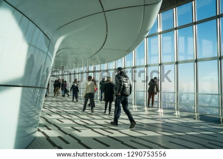 Milan Italy - January 6, 2019: people admire the view on Milan from the windows of Jannacci belvedere (viewpoint) at Pirelli skyscraper, designed by Gio Ponti. #1290753556
