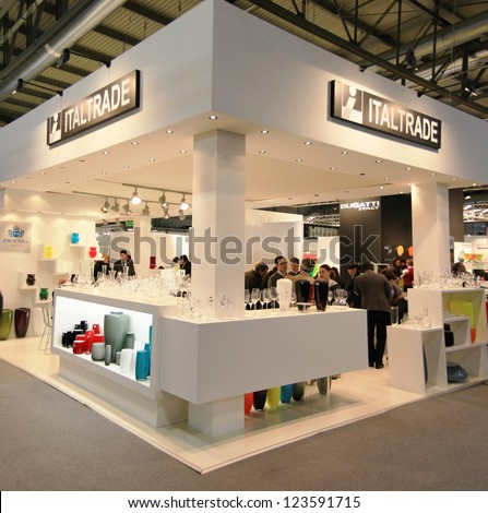 MILAN, ITALY - JANUARY 28: People look at design and interior decoration products stand at Macef, International Home Show Exhibition on January 28, 2011 in Milan, Italy.