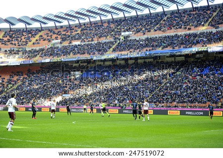 MILAN, ITALY-JANUARY 25, 2015: soccer stadium fans gathering at the san siro stadium for the serie A match FC Internazionale vs Torino, in Milan.
