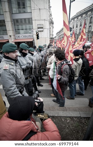 MILAN, ITALY - JANUARY 28: student demonstration held in Milan January 28, 2011. Students protest against Berlusconi's government calling for his resignation from the government. #69979144