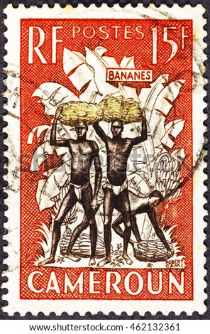 Milan, Italy - July 21, 2016: Banana carriers on postage stamp of Cameroon #462132361