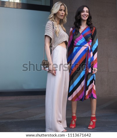 MILAN, ITALY -JUNE 15, 2018: Fashionable women posing for photographers in the street after ALBERTA FERRETTI fashion show, during Milan Fashion Week Men and women spring  #1113671642