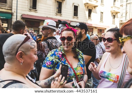 MILAN, ITALY - JUNE 25: People at Pride parade in Milan JUNE 25, 2016. Thousands of people march in the city streets for the annual Pride parade, claiming equality and legal rights. #443537161