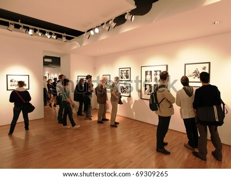 MILAN, ITALY - JUNE 16: People look at Phil Stern photography collection at Forma Photography Foundation June 16, 2010 in Milan, Italy.