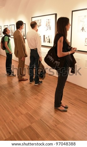 MILAN, ITALY - JUNE 16: People look at Phil Stern photos during exhibition opening at Forma Photography Foundation June 16, 2010 in Milan, Italy.