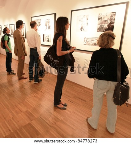 MILAN, ITALY - JUNE 16: People look at Phil Stern photos exhibition opening at Forma Photography Foundation June 16, 2010 in Milan, Italy.