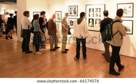 MILAN, ITALY - JUNE 16: People looking at Phil Stern photograhy exhibition at Forma Photography Foundation June 16, 2010 in Milan, Italy.