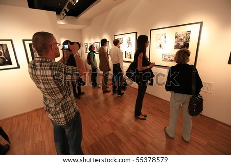 MILAN, ITALY - JUNE 16: People visit american photographer Phil Stern exhibition at Forma, International Center of Photography June 16, 2010 in Milan, Italy.