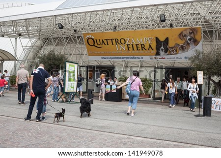 MILAN, ITALY - JUNE 8: Quattrozampe in fiera exhibition in Milan, JUNE 8, 2013. People and dogs visit Quattrozampe in fiera exhibition, important event dedicated to dogs and their owners.
